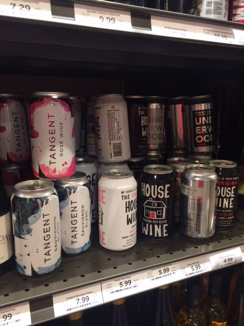 Wine cans from different wineries on a shelf at large discount wine store